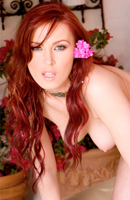 Red haired lustful model Alexandra Ivy is showing off her...