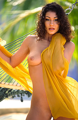 Curly Latina Alicia Burley poses in a summer paradise, on a...