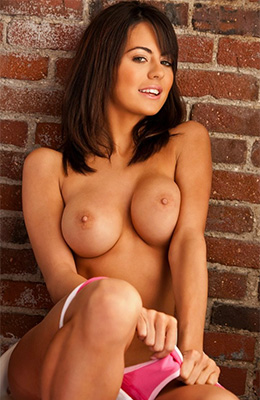 Tanned brunette with firm, medium boobs, Audrey Nicole is...