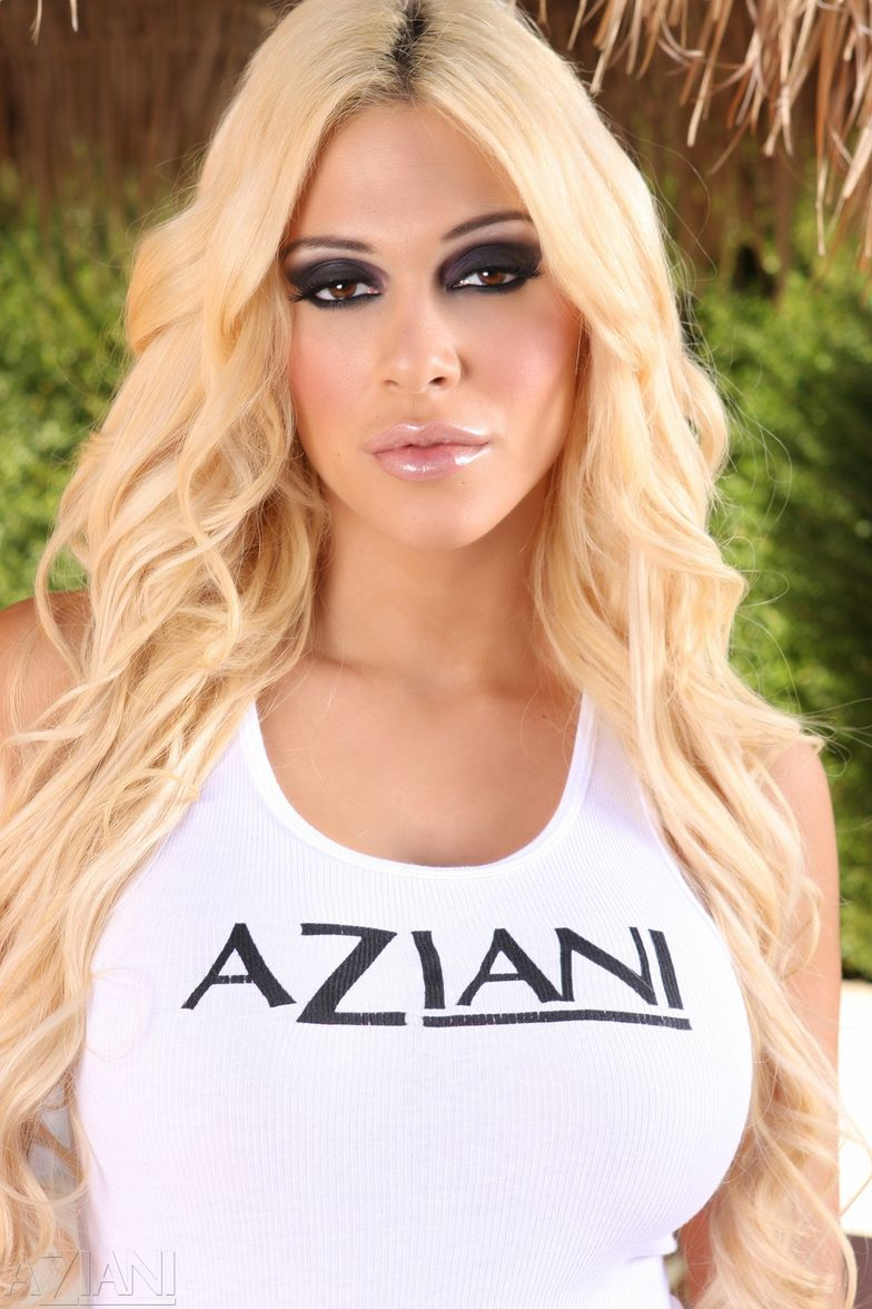 carmel moore - carmel moore is posing in an aziani shirt but not for