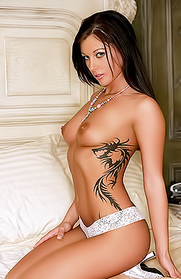 Dark haired tanned babe with naturally small boobs and rib...