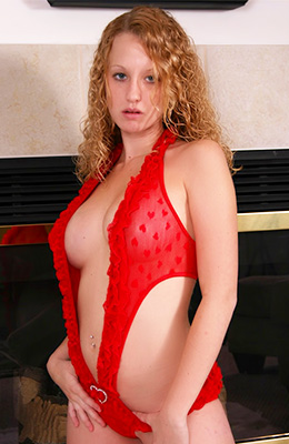 Blue- eyed blonde chick with curly hair is wearing red, lacy...