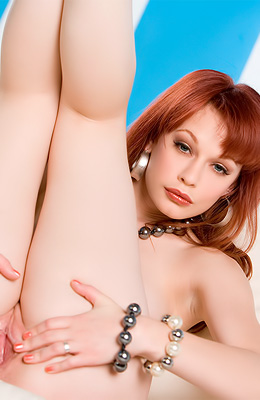 Justine Joli is one of not so many red haired babes who have...