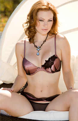 Red haired model Kimberly Phillips is in the mood to show...
