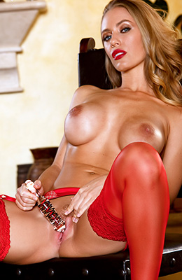 Enchanting blonde hottie Nicole Aniston poses in sexy red...