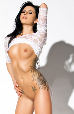 Tattooed model Nikita Anna is oiled up and more than willing...