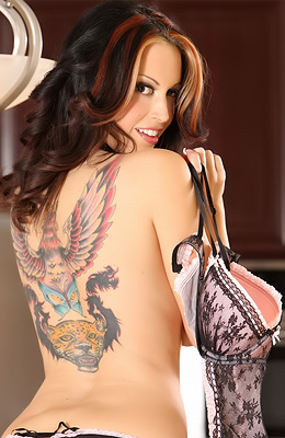 Nikki Nova is a wild thing with a huge tattoo all down her...