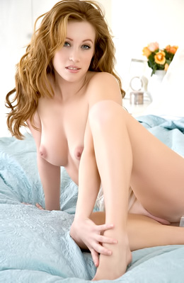 Red haired model Priscilla Clark is showing off her stunning...
