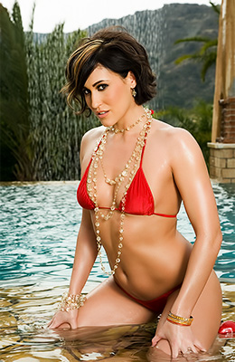 Dark haired woman in red bikini, Ryan Keely realized that...