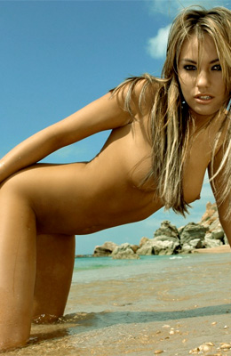 While kneeling on the hot sand, stunning Veronika Fasterova...