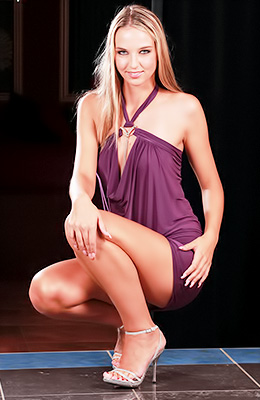 Gorgeous blonde babe Veronika J takes her purple dress off...