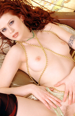 Curly redhead darling Heather Marie Hoke is in the center of...