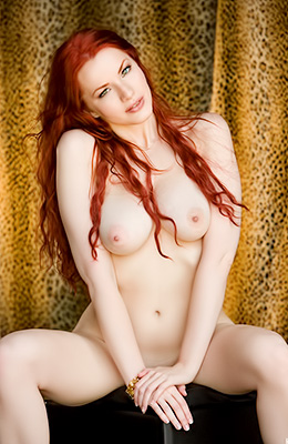 Stunning red haired beauty Kinsey Elizabeth is posing in...