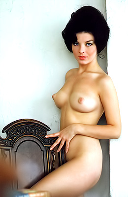 Dark haired babe with a vintage vibe in her looks, Terri...