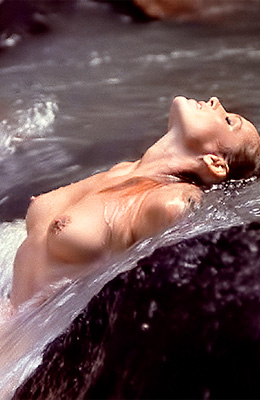 Sexy woman, Ursula Andress knows that she looks amazing when...